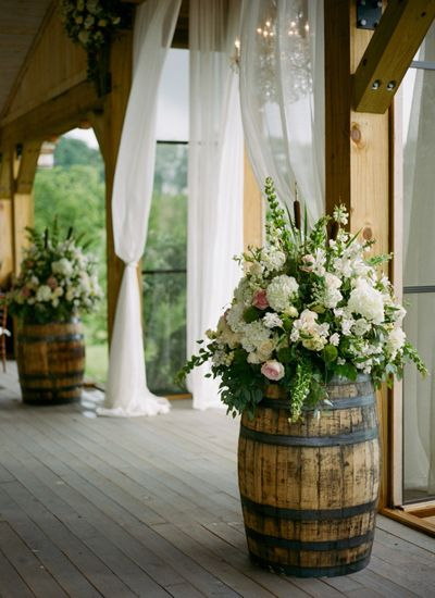 Wine-Barrels-Decorated-With-Colorful-Flower-Bouquets